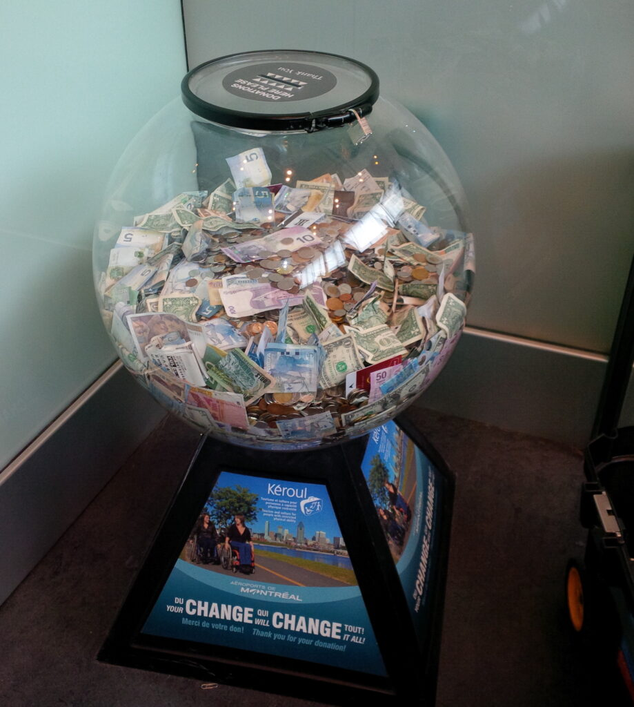Globe filled with foreign and Canadian currency for charity